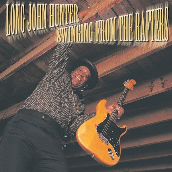 """Hunter y sus acrobacias en la portada de """"Swinging From The Rafters"""" (1997)"""
